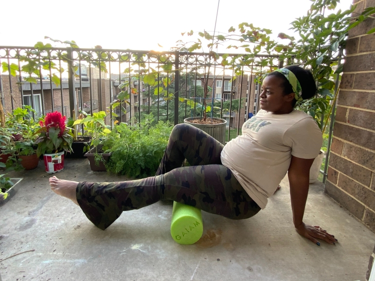 Michelle using a green foam roller on the hamstring