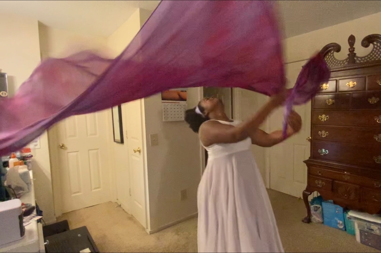 Michelle worshiping with purple flags